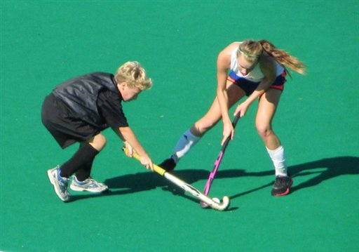 In this undated photo provided by Andrew Pilaro, Keeling Pilaro, 13, left, plays offense as a member of the East End Field Hockey club in New York. Pilaro, who grew up playing field hockey in Ireland, has been told that after two years as a member of the Southampton High School girls' team, he is now too skilled to qualify for an exemption allowing him to compete with, and against, girls next season.