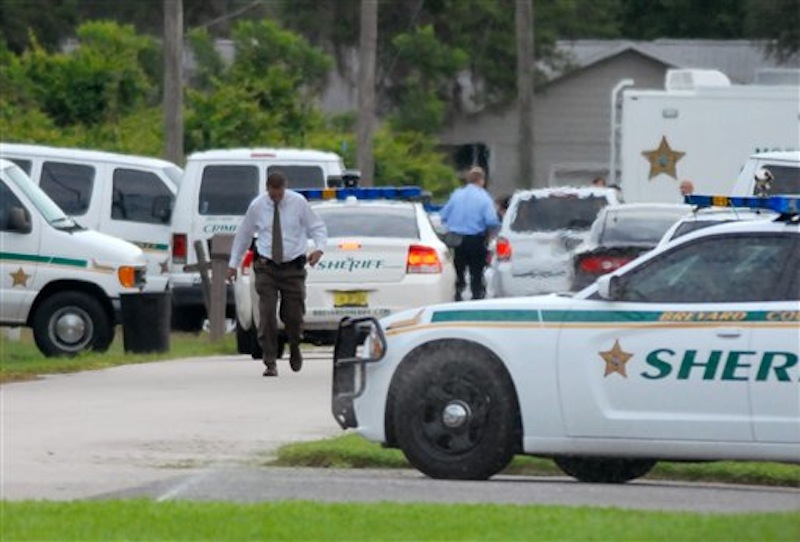 Emergency personel surround the scene of a multiple shooting in Port St. John, Brevard County, Fla., Tuesday, May 15, 2012. Sheriff's deputies in Brevard County said 33-year-old Tanya Thomas on Tuesday shot her four children, who ranged in age from 12 to 17, before shooting herself. (AP Photo/Florida Today,Tim Shortt) murder;suicide;killings;PSJ shootings