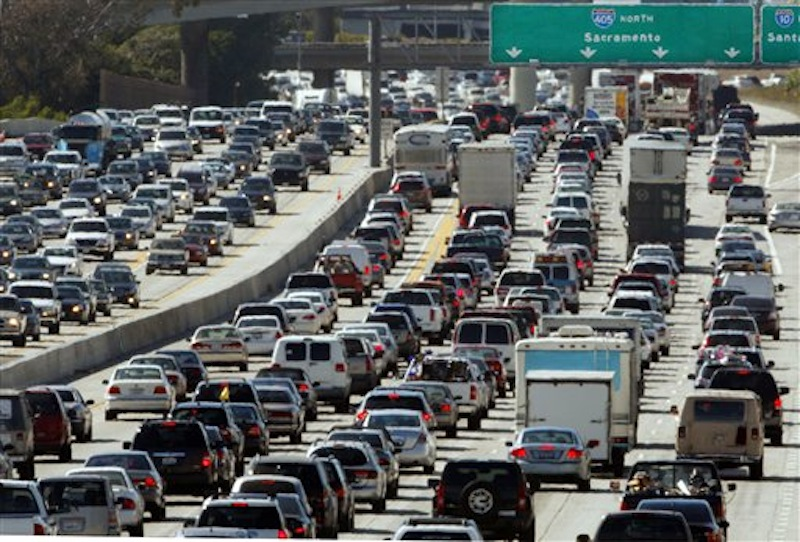 In this May 28, 2010 file photo, the rush hour commute starts in early afternoon and with greater intensity as traffic is jammed in both directions on Interstate 405 on the Westside of Los Angeles as commuters and vacationers hit the road. More Americans will hit the road this holiday weekend than a year ago. And they'll have a little extra money to spend thanks to lower gas prices. It's Memorial Day weekend and our obsession with the price of gasoline is in focus again. (AP Photo/Reed Saxon, file)