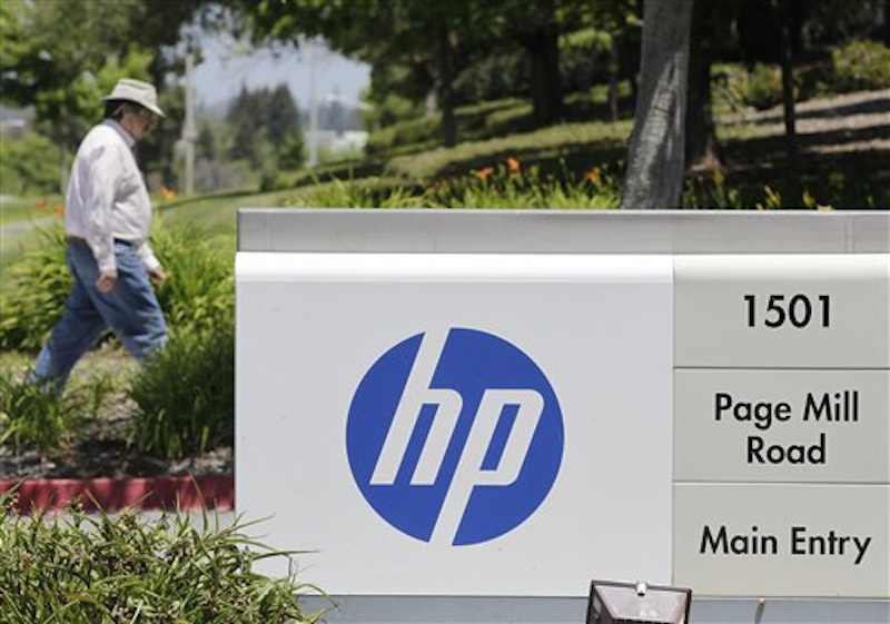 A Hewlett-Packard worker walk in the main entrance of HP Headquarters in Palo Alto, Calif., Thursday, May 17, 2012. Published reports say HP is poised to eliminate up to 30,000 jobs to help offset dwindling demand for personal computers as more people connect to the Internet on smartphones and tablets. Bloomberg News says HP is mulling 25,000 job cuts. All Things D, a technology blog, estimates the purge will jettison 30,000 jobs. Both reports cited unnamed people familiar with HP's plans. Hewlett-Packard Co. declined to comment Thursday. (AP Photo/Paul Sakuma)