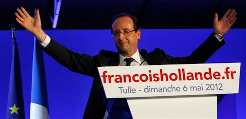 President-elect Francois Hollande waves to the crowd after his election in Tulle, central France, Sunday, May 6, 2012. Francois Hollande defeated Nicolas Sarkozy on Sunday to become France's next president, Sarkozy conceded defeat minutes after the polls closed. (AP Photo/Christophe Ena)