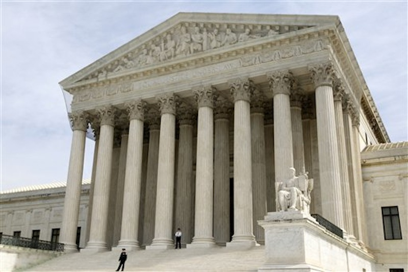 In this March 28, 2012 file photo, the Supreme Court is seen in Washington. The Supreme Court won't reduce the $675,000 verdict against a Boston University student who illegally downloaded 30 songs and shared them on the Internet. (AP Photo/Charles Dharapak, File)