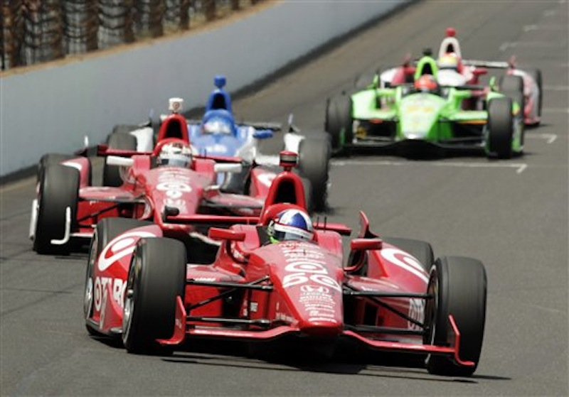 Dario Franchitti, of Scotland, leads teammate Scott Dixon, center, of New Zealand, and Takuma Sato, of Japan, into the first turn during IndyCar's Indianapolis 500 auto race at Indianapolis Motor Speedway in Indianapolis, Sunday, May 27, 2012. (AP Photo/AJ Mast)