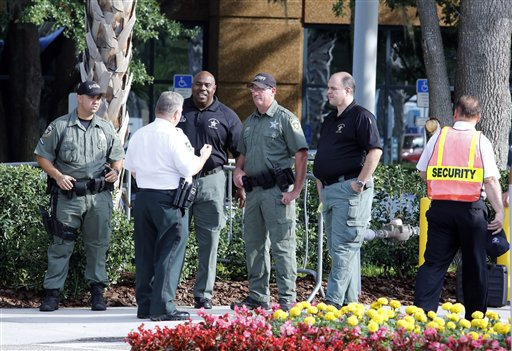 Hillsborough, Fla., sheriff deputies patrol outside the gate of JPMorgan Chase annual stockholders meeting held today in Tampa.