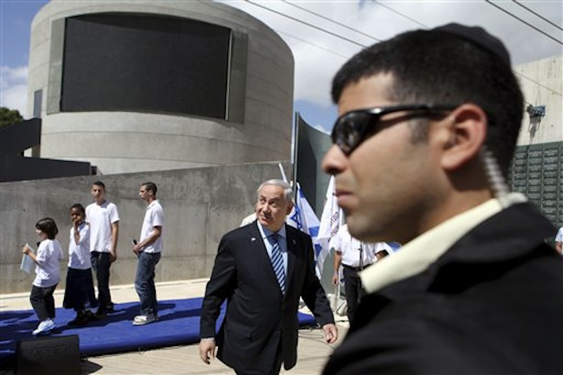 Israeli Prime Minister Benjamin Netanyahu arrives for a special cabinet meeting marking 'Jerusalem Day' in the Ammunition Hill memorial in Jerusalem, Sunday, May 20, 2012. 'Jeruslem Day' marks the anniversary of Israel's capture of the eastern part of the city in the 1967 Mideast war. (AP Photo/Abir Sultan, Pool)