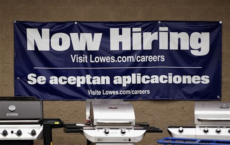 A Lowes store advertises job openings near its gas grills outside the home improvement store in Pembroke, Mass., Tuesday, May 8, 2012. The Labor Department said Tuesday that U.S. companies in March posted the highest number of job openings in nearly four years, a sign that hiring could strengthen in the coming months after slowing this spring. (AP Photo/Stephan Savoia)