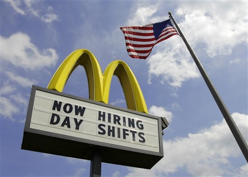 This May 2, 2012, file photo shows a sign advertising job openings outside a McDonalds restaurant in Chesterland, Ohio. The Labor Department said Tuesday, May 8, that U.S. companies in March posted the highest number of job openings in nearly four years, a sign that hiring could strengthen in the coming months after slowing this spring. (AP Photo/Amy Sancetta, File)