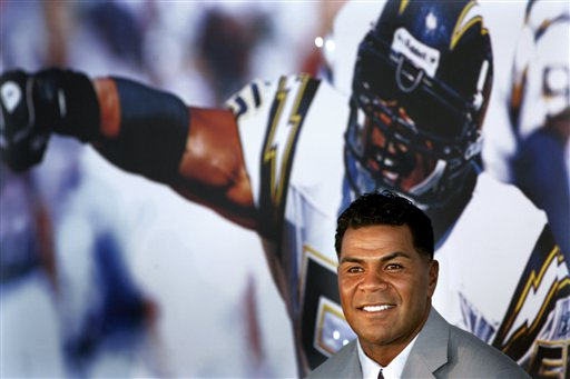 In this Aug. 14, 2006, file photo, former Patriots linebacker Junior Seau appears at a news conference announcing his retirement from football.