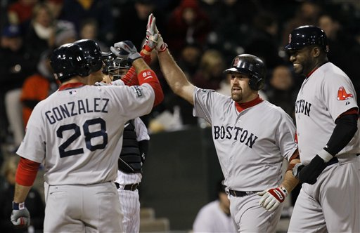 Boston Red Sox's Kevin Youkilis, center, celebrates a grand slam Thursday, April 26, 2012, in Chicago. Youkilis has been activated off the 15-day disabled list. (AP Photo/Charles Rex Arbogast)