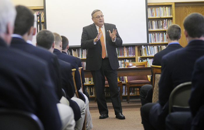 Gov. Paul LePage speaks with Cheverus High School students about domestic violence today in a library in the high school's Loyola Hall.