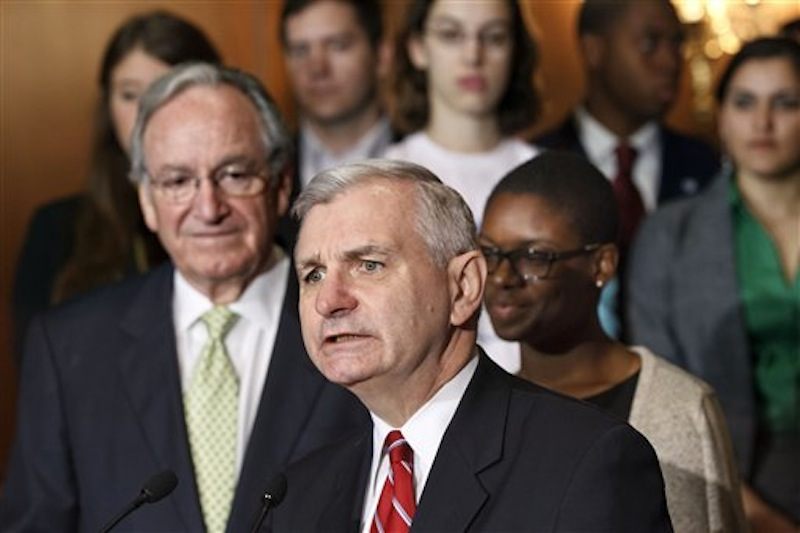 Sen. Jack Reed, D-R.I., center, accompanied by Sen. Tom Harkin, D-Iowa, left, and students, speaks at a news conference on Capitol Hill in Washington today, as the Senate moves toward a showdown on a Democratic proposal to keep federally subsidized loan interest rates from doubling for millions of college students. Clarise McCants of Philadelphia, right, a Howard University political science major, added her own appeal to the senators. (AP Photo/J. Scott Applewhite)