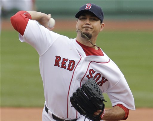 Boston Red Sox starting pitcher Josh Beckett delivers to the Seattle Mariners at Fenway Park in Boston on Tuesday. The Red Sox won 5-0.
