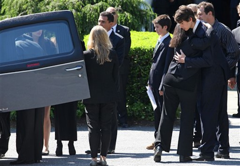 Members of Mary Richardson Kennedy's family embrace as the casket holding Kennedy, the estranged wife of Robert F. Kennedy Jr., arrives at St. Patrick's Church in Bedford, N.Y. Saturday, May 19, 2012. Kennedy was found dead of an apparent suicide this week at her home in Bedford. (AP Photo/Craig Ruttle)