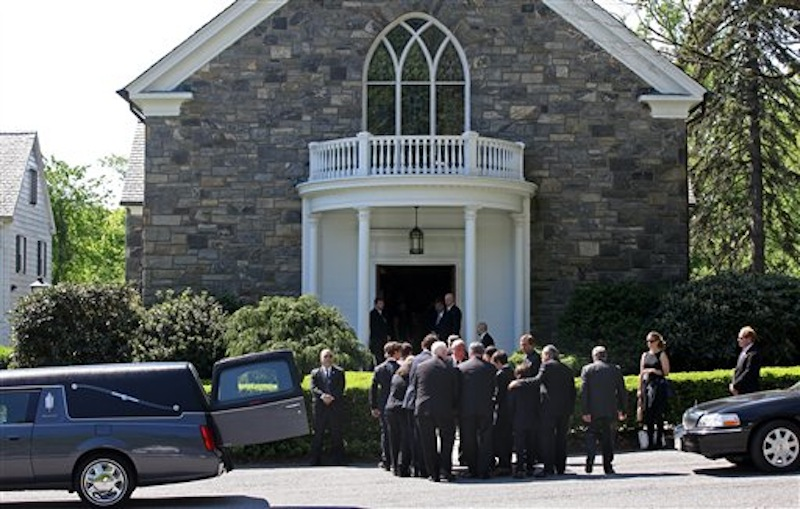 Members of Mary Richardson Kennedy's family remove the casket holding her, the estranged wife of Robert F. Kennedy Jr., at St. Patrick's Church in Bedford, N.Y., Saturday, May 19, 2012. Kennedy was found dead of an apparent suicide this week at her home in Bedford. (AP Photo/Craig Ruttle)