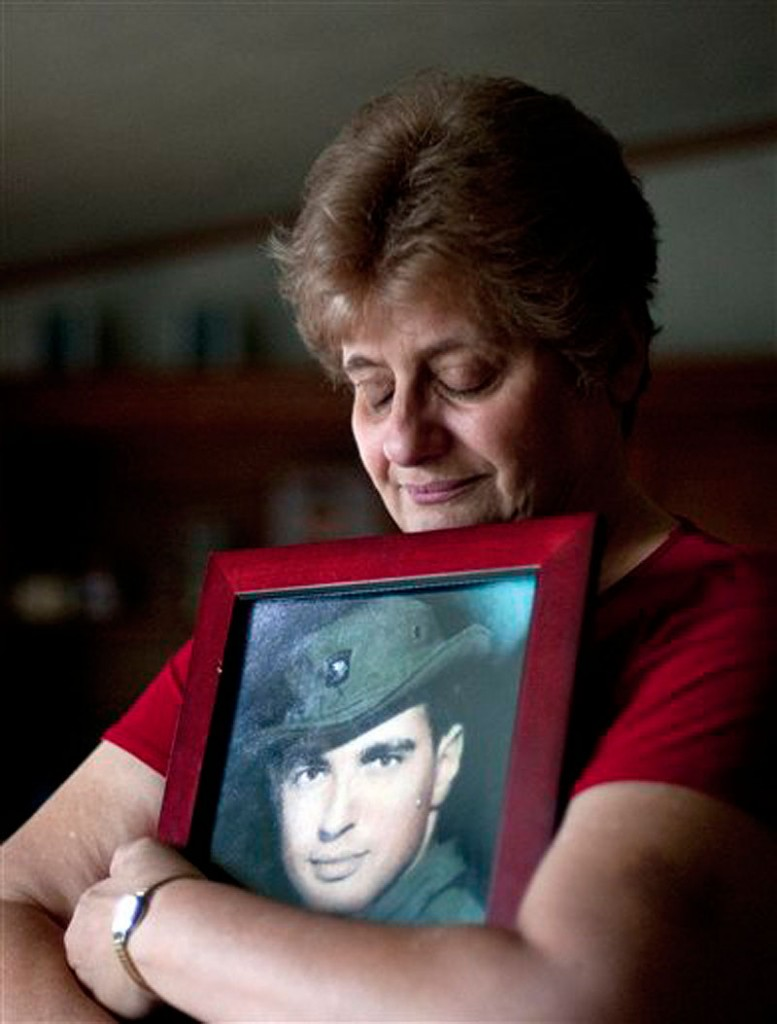 In a May 10, 2012 file photo Rose Mary Sabo-Brown holds a photo of her husband Army Specialist Leslie H. Sabo, Jr., in her home in New Castle, Pa. Sabo was killed in 1970 in Cambodia during the Vietnam War and is to posthumously receive the Medal of Honor in a ceremony at the White House Wednesday May 16, 2010. (AP Photo/Andrew Russell, Tribune-Review, file)