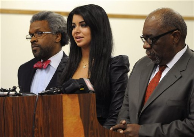 In this April, 11, 2012, file photo former Miss USA Rima Fakih, center, stands before the court with city attorney Todd Russell Perkins, left, and her attorney Otis Culpepper, for her drunken driving case in Highland Park, Mich. Fakih, the first Arab-American to be crowned Miss USA, was sentenced Wednesday, May 9, 2012, to probation and community service. The judge put her on six months' probation, ordered 20 hours of community service and said she must pay fines and costs. (AP Photo/The Detroit News, Charles V. Tines, File) DETROIT FREE PRESS OUT; HUFFINGTON POST OUT; MAGS OUT; NO ARCHIVE; MANDATORY CREDIT