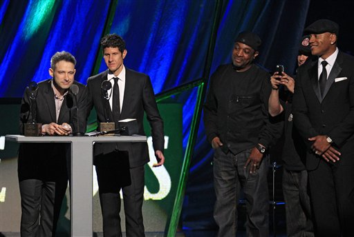 Adam Horovitz, left, and Mike Diamond of the Beastie Boys accept induction into the Rock and Roll Hall of Fame on April 14 in Cleveland. Adam Yauch, who died today of cancer, was absent from the ceremony.