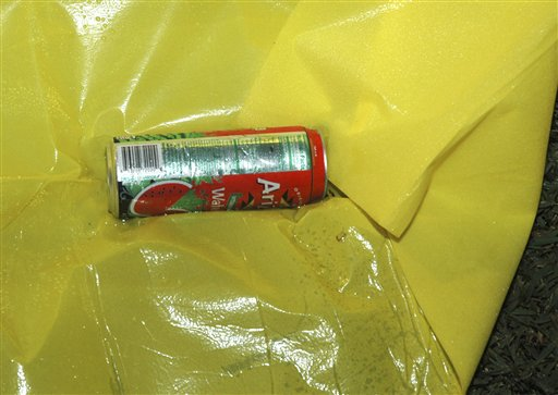 This Feb. 26, 2012, photo released by the Florida State Attorney's Office shows a can of Arizona Watermelon Fruit Juice Cocktail at the scene where Trayvon Martin was shot by neighborhood watch volunteer George Zimmerman.