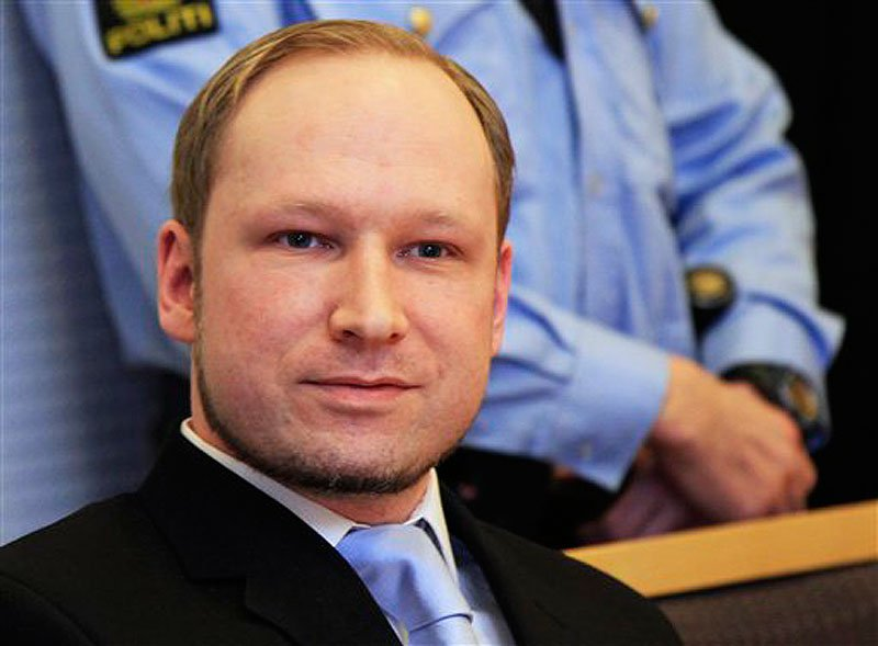 In this Feb. 6, 2012 photo, Anders Behring Breivik, a right-wing extremist who confessed to a bombing and mass shooting that killed 77 people on July 22, 2011, arrives for a detention hearing at a court in Oslo, Norway. (AP Photo/Lise Aserud, Scanpix Norway)