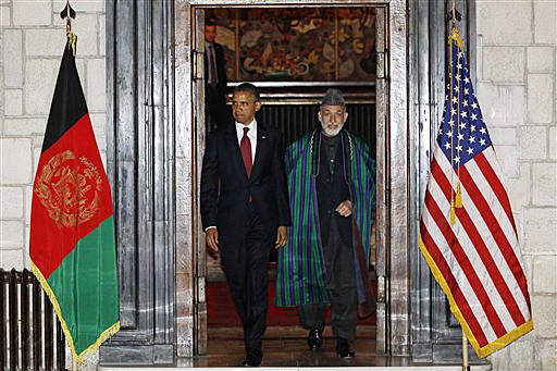 President Barack Obama and Afghan President Hamid Karzai arrive at the presidential palace in Kabul today.