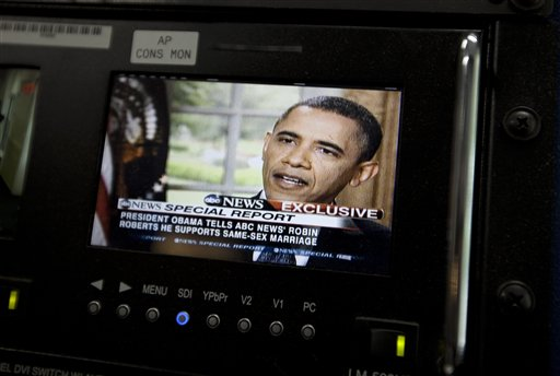President Barack Obama's interview with ABC News appears on a monitor in the White House briefing room today.