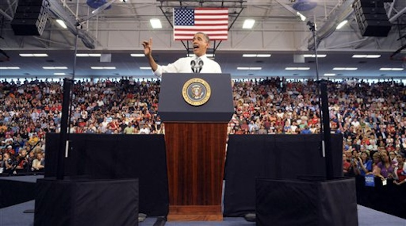 President Barack Obama waves as he delivers an address on the economy, jobs and taxes at Florida Atlantic University in Boca Raton, Fla., Tuesday, April 10, 2012. (AP Photo/South Florida Sun Sentinel, Mark Randall)