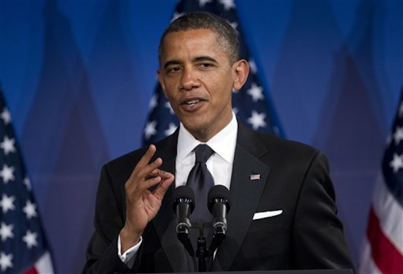 In this May 8, 2012 file photo, President Barack Obama speaks in Washington. Obama's popularity among women, minorities and independents is giving him an early edge over his likely GOP rival, Mitt Romney, according to a new AP-GfK poll. But Americans are split over which candidate can best handle the economy, which might open pathways for Romney. (AP Photo/Evan Vucci, File)