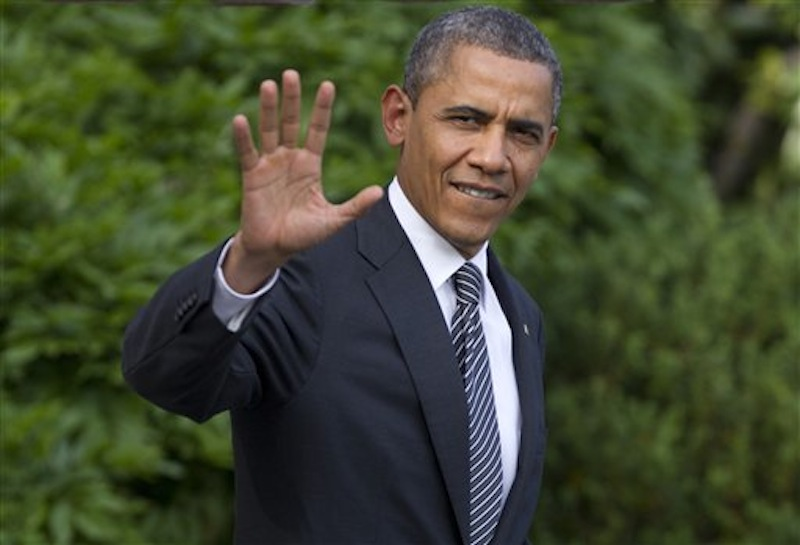 President Barack Obama waves as he walks from the White House in Washington, Friday, May 18, 2012, to board Marine One, as he travels to Camp David for the G8 Summit. Obama is calling on Congress to put into place new banking laws he signed in to law two years ago, instead of trying to weaken them. (AP Photo/Carolyn Kaster)