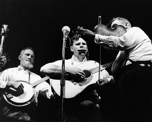 In this July 24, 1963, photo, Doc Watson, center, performs with the Watson Family on the opening night of the Newport Folk Festival in Newport, R.I.