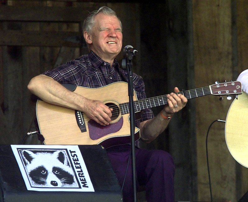Master flatpicker Doc Watson performs at the annual Merlefest at Wilkes Comunity College in Wilkesboro, N.C., in 2001. Watson died today at a hospital in Winston-Salem.