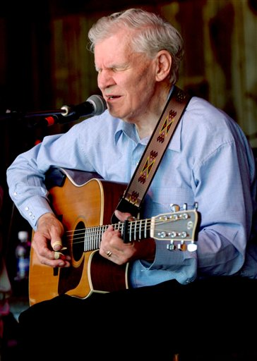 In this May 1, 2005, photo, master flatpicker Doc Watson plays during the