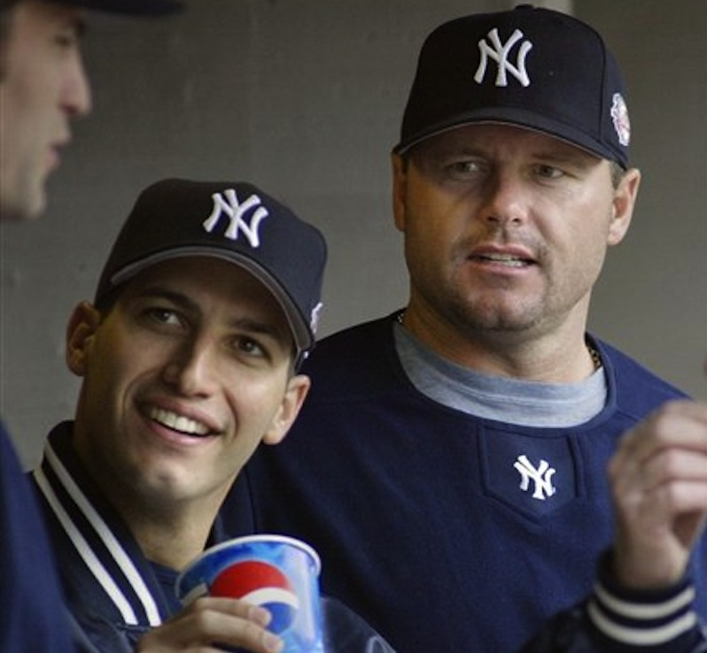 This May 31, 2003 file photo shows New York Yankees pitchers Andy Pettitte, left, and Roger Clemens talking with a teammate during a baseball game against the Detroit Tigers, in Detroit. Pettitte took the stand Tuesday in the Clemens perjury trial to testify against his former teammate. (AP Photo/Duane Burleson, File)