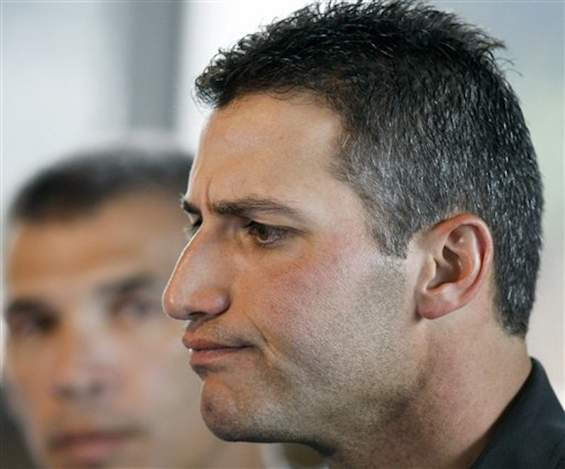 In this Feb. 18, 2008 file photo, then-New York Yankees' baseball pitcher Andy Pettitte answers questions during a news conference in Tampa, Fla. about Roger Clemens alleged steroid use. (AP Photo/Julie Jacobson, File)