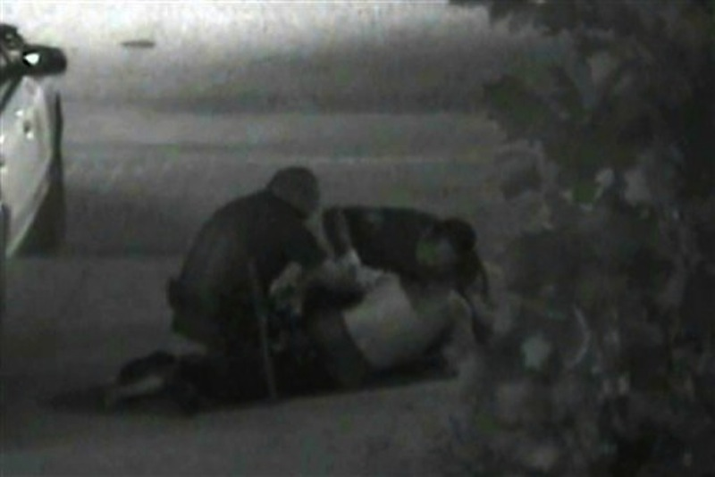 This still photo taken from a security camera released on Monday May 7, 2012 by the Orange County District Attorney shows an altercation between Fullerton police officers and homeless Kelly Thomas at the Fullerton bus depot on July 5,2011. The grainy black and white video of Thomas' violent encounter with police outside a bus depot is the centerpiece of the prosecutions' case against two officers accused of escalating a standard police encounter with a homeless man into a fatal beating. (AP Photo/Orange County District Attorney)