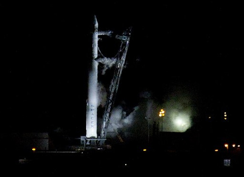 The Falcon 9 SpaceX rocket sits on the launch pad at complex 40 moments after the launch was aborted due to technical problems at the Cape Canaveral Air Force Station in Cape Canaveral, Fla., early Saturday, May 19, 2012.(AP Photo/John Raoux)