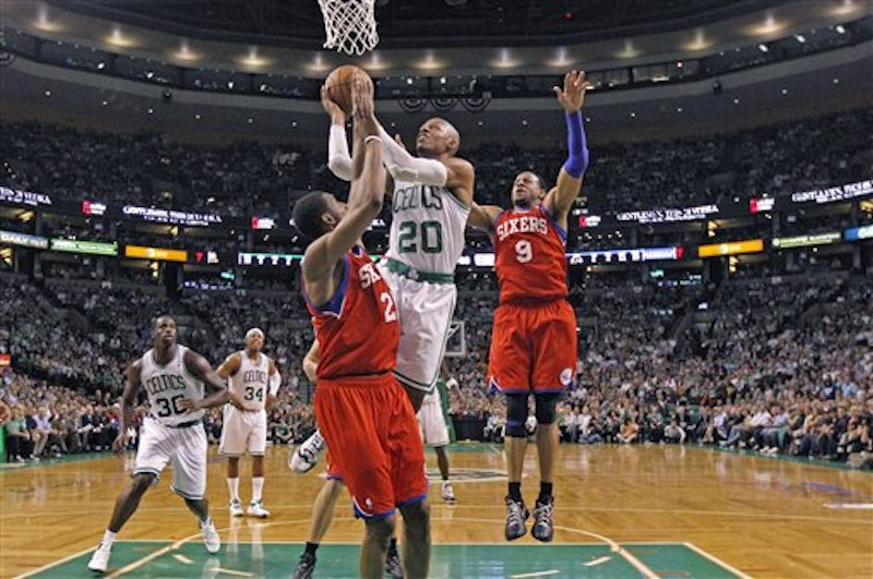 Boston Celtics' Ray Allen (20) drives past Philadelphia 76ers' Andre Iguodala (9)and over 76ers Thaddeus Young during the second quarter of Game 5 in their NBA basketball Eastern Conference semifinal playoff series in Boston, Monday, May 21, 2012. (AP Photo/Charles Krupa)