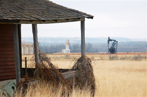 A nodding donkey pump extracts oil from the earth at an abandoned farm near the old ghost town of Dore, N.D. Dore has seen a rebirth with the booming oil activity in western North Dakota.
