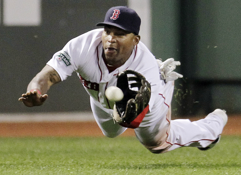 Boston Red Sox center fielder Marlon Byrd dives to catch a fly ball by Detroit Tigers' Gerald Laird during the eighth inning of the game at Fenway Park in Boston on Wednesday. The Red Sox won 6-4.
