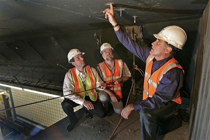 In this July 18, 2006, file photo, Gov. Mitt Romney, right, looks over bolts in the ceiling of a Big Dig tunnel while speaking with Alexander Bardow, center, Massachusetts Director of Bridges and Structures, and Massachusetts Secretary of Transportation John Cogliano in Boston. Romney was at his New Hampshire vacation home on a summer night in 2006 when tons of concrete ceiling panels in one of Bostonís Big Dig highway tunnels collapsed. The debris crushed a car and killed a female passenger. Romney, then in his final year as Massachusetts governor, dashed back to Boston and immersed himself in the crisis. His response offers insights into what kind of leader the expected Republican nominee would be if elected president. Romney has made his management skills a major selling point in his campaign. (AP Photo/David L Ryan, Pool)