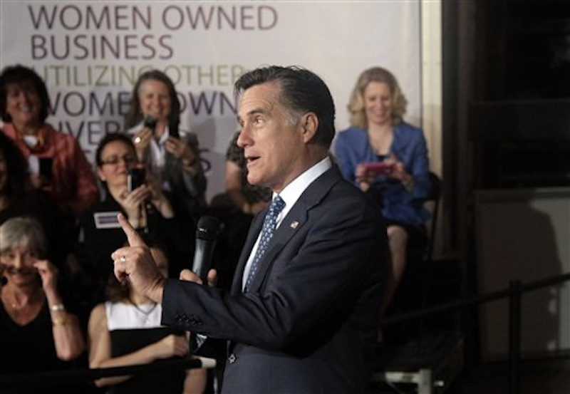 In this May 2, 2012 file photo, Republican presidential candidate, former Massachusetts Gov. Mitt Romney speaks in Chantilly, Va. Romney's courtship of female voters in his speeches sounds a bit like a movie casting call: Woman Whose Husband Took an Upholstery Class. Woman Who Is Back in College to Dodge Her Student Loans. Woman Who Owns Duplexes. Romney's campaign won't identify these women, making it impossible to check on his accounts. But they're serving an important role as Romney looks to narrow the advantage President Barack Obama has with women. (AP Photo/Jae C. Hong, File)
