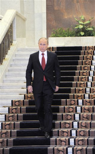 Russian Prime Minister Vladimir Putin leaves the government headquarters to take part in his inauguration ceremony as new Russia's president today.