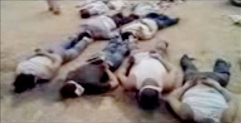 In this image made from amateur video released by the Shaam News Network and accessed Tuesday, May 29, 2012, purports to show 13 blindfolded and handcuffed bodies on the ground in Deir el-Zour, Syria. U.N. observers have discovered 13 bound corpses in eastern Syria, many of them apparently shot execution-style, the monitoring mission said Wednesday. (AP Photo/Shaam News Network via AP video)