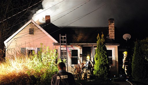 Firefighters battle a blaze on Paul Street in Auburn late Tuesday night. Richard and Bonnie Desjardings escaped the fire uninjured with two of their three dogs, but were looking for the third they hoped made it into the backyard. It was one of two fires in the community Tuesday night.