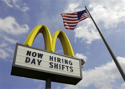 A McDonalds restaurant in Chesterland, Ohio, advertises job openings on Wednesday. The number of people seeking unemployment benefits fell last week by the most in more than three months, the Labor Department reported today.