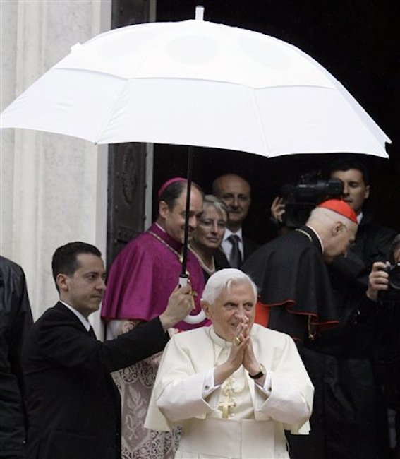 In this May 17, 2008 file photo, Pope Benedict XVI acknowledges faithful upon his arrival at the Our Lady of Mercy Shrine in Savona, near Genoa, Italy. The Vatican has confirmed Saturday, May 26, 2012, that the pope's butler Paolo Gabriele, at left holding the umbrella, was arrested in an embarrassing leaks scandal. Spokesman the Rev. Federico Lombardi said Paolo Gabriele was arrested in his home inside Vatican City with secret documents in his possession. (AP Photo/Luca Bruno, file)