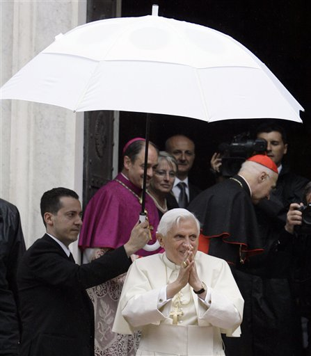 In this May 17, 2008, file photo, Pope Benedict XVI's butler, Paolo Gabriele, left, holds an umbrella for the pontiff as Benedict arrives at a shrine in Savona, Italy. Gabriele, arrested for allegedly having confidential Vatican documents in his home, has agreed to cooperate with investigators.