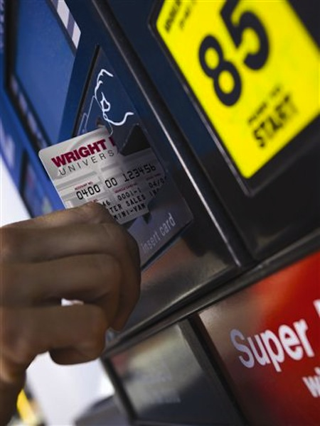 A Wright Express credit card is used at an ExxonMobil gas station.