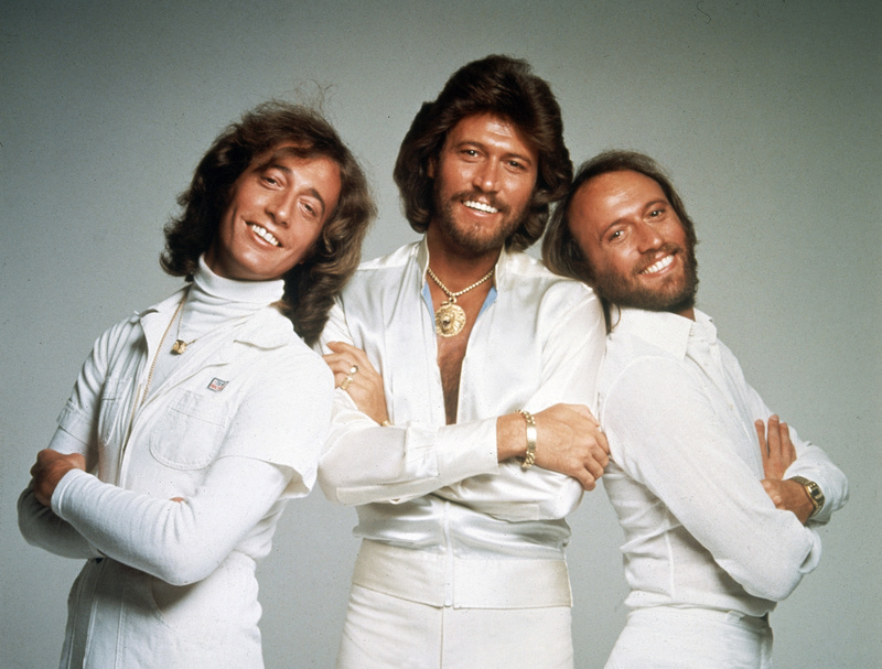 In this January 1979 file photo, the Bee Gees – from left, Robin, Barry and Maurice Gibb – pose for photographers, somewhere in England.
