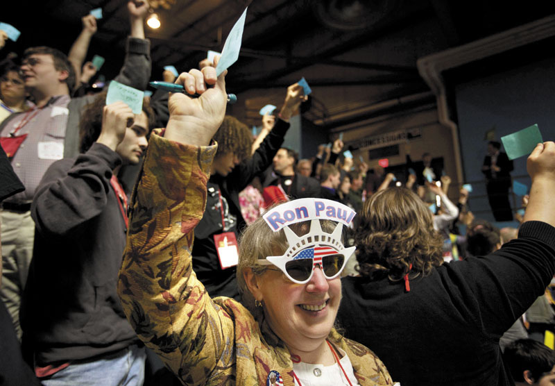 Linda Silvia of China, a delegate from Kennebec County, holds up a blue card Saturday while voting for Ron Morrell to be convention secretary during the Maine Republican Convention at the Augusta Civic Center. Ron Paul won the majority of delegates from Maine.