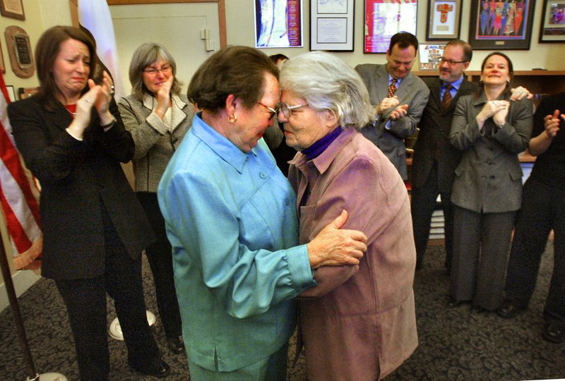 Longtime gay activists Phyllis Lyon, left, and Del Martin embrace in front of San Francisco City Hall after being married Feb. 12, 2004.